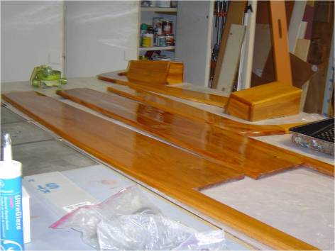 Most of the exterior teak was replaced with stainless steel except the cock pit comings and dorades became Honduras mahogany with epoxy and varnish finish.