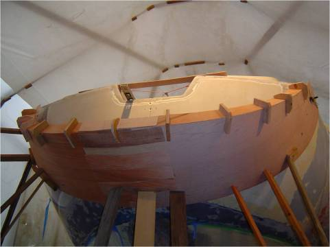 We cut a section of transom out for pass through and built a mold for the layup of the scoop out of door-skin.