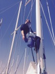 Our lovely niece, Karrin, scrubbing her way down the 62' mast.  She's fearless.