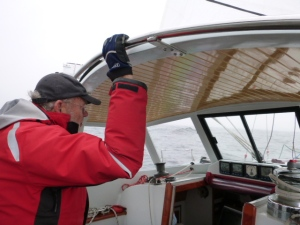 """The Skipper"" on watch. The three of us rotated every two hours except at night we had two on at a time which added greatly to the safety factor."