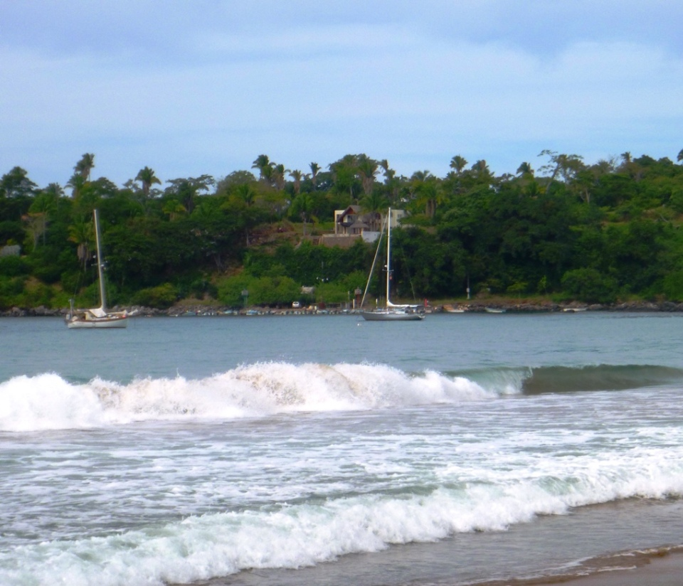 Carmanah, happy at anchor, just outside the surf line at Chacala.