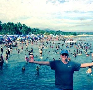 Dave on a La Cruz beach with scores of Holy Week vacationers. Shortly after returning home, he was hospitalized with a severe case of dengue fever