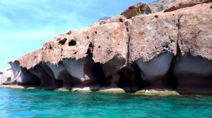 The erosion at these pink cliffs in Ensenada Grande are filled with caves.