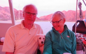"""Don and Emily are not suffering from a nasty sunburn, the sunset at Balandra Cove is just reflecting off their faces as we have enjoy some """"sundowners""""."""