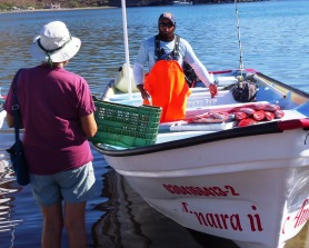 Donna bartering for some red snapper with a San Evaristo fisherman returning from a night of fishing. It was delicious.