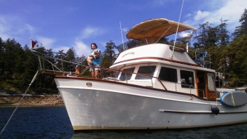 Donna and Lucy very happy to be in Desolation Sound in warm weather and warm water. Anchored here in the Copeland Islands.