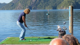 Sullivan Bay in the Broughtons is a 100% floating town complete with driving range. Closest to the flag gets free moorage for the night. We didn't win but Linda is in good form going for the money shot here.