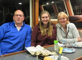 Karrin with her proud parents--Owen and my sister Lisa--aboard Restless in Bellingham.