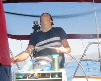 Our nephew Mason is a natural at the helm tackiong up wind in light wind to get through the rocks on our way south to Barra de Navidad.