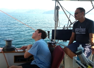 "Mason trims the spinnaker as we ""ghost"" our way into the Tenacatita anchorage in 3 knots of wind."