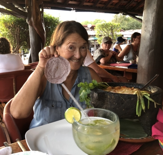 Donna enjoying a Molcajete dish (the huge stone bowl) at Banditos resturant in Zihua. These pre-hispanic bowls are traditionally carved out of a single block of rock