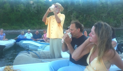 "The Mayor's (dinghy) Raftup in on Fridays in Tenacatita. Traditiion dictates that you blow into a conch shell at sunset. Donna found one but a crab was in residence so we threw it back in the sea. Robert (standing) is the longtime ""mayor"" of the bay."