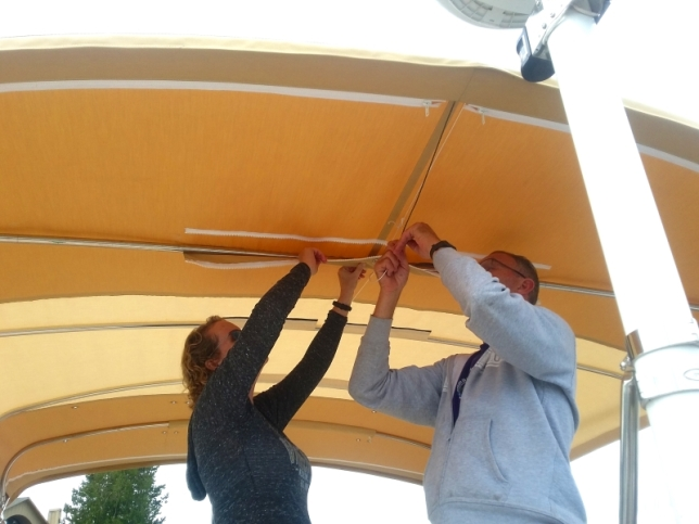 "Linda & I putting the bimini up after adding a 60"" section to the middle. The extra protection was really nice."