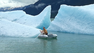 Lucy wanted shore leave as we motored up Tracy Arm so we launched the dinghy and rowed over to the nearest berg.
