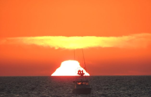 "Always trying to capture a ""green flash"" on film, Donna got this crazy shot as we were leaving Banderas Bay."