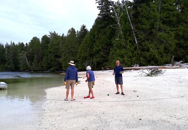 Before rounding Cape Caution on our way down to Vancouver Island, we stopped at beautiful Fury Cove. (These names sound daunting at times) A little bocce ball game on the white shell beach with the crew of Liberty.