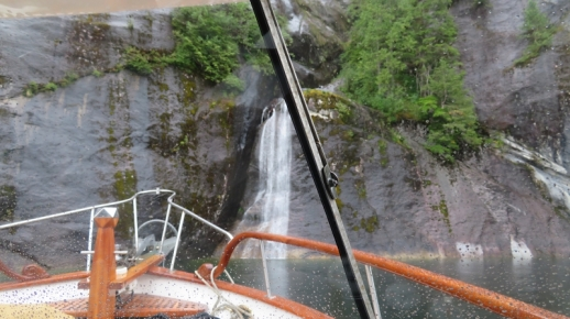 There are so many waterfalls in Punchbowl Cove (Misty Fjords National Monument 40 Miles E of Ketchikan) the we thought we could nose Restless' bow under one for some free water.