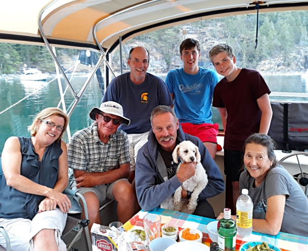 Restless' flybridge is always a great place to gather for sundowners, here with the Witty family and Bob from Bainbridge all hanging out in Desolation.